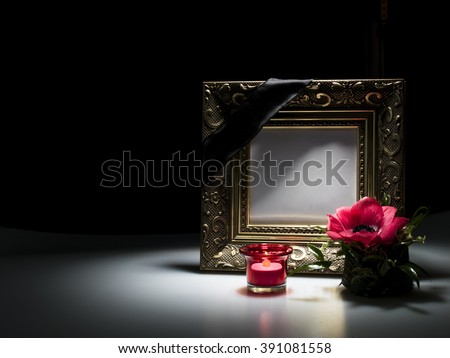 blank mourning frame for sympathy card on dark background