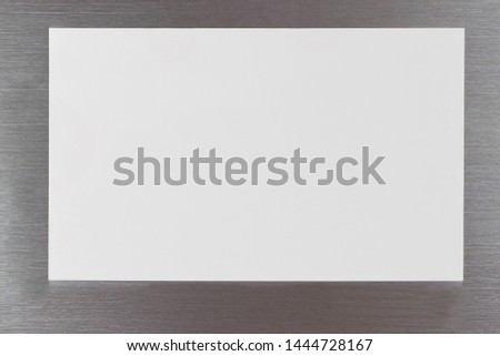 Blank name card white color paper on silver background. #1444728167