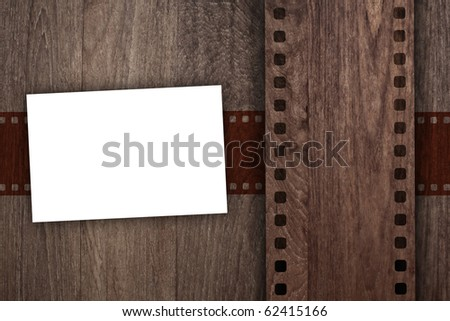 blank name card with emboss film stripe for image on wooden background
