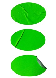 Blank neon green ovals paper sticker label set crumpled isolated on white background