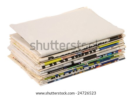 Blank newspaper on a pile of other newspapers