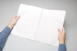Blank Newspapers in hands Mock-up.