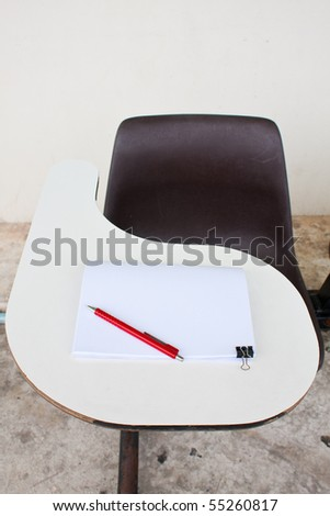 blank note and the pencil on the desk
