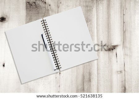 Blank note book on wood  texture background. #521638135