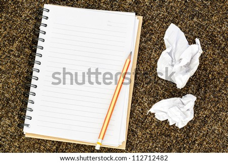 Blank note book with crumpled paper - stock photo