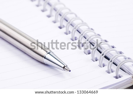 Blank note paper with silver pen