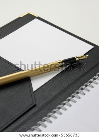 blank note with  pen  on the plain background