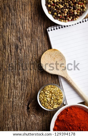 blank notebook and spices on wooden table