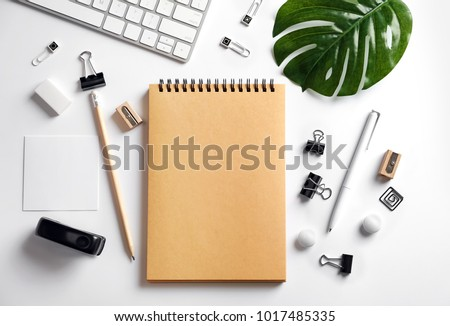 Blank notebook and stationery on white background. Mockup for design #1017485335