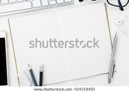 Blank notebook is open on modern white working table. Top view. Stock photo ©