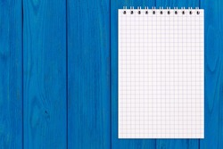 Blank notebook on a wooden background, copy space, top view