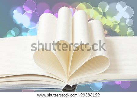 Blank notebook on beautiful light bokeh background