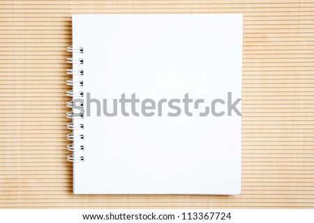 Blank notebook on brown paper background