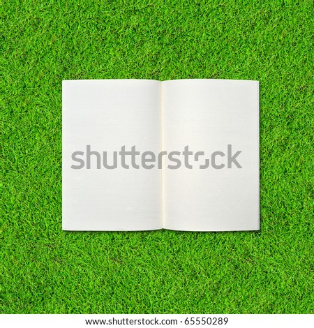 Blank notebook on Green Grass background.