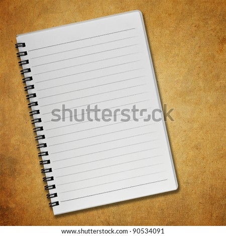 Blank notebook on old paper background