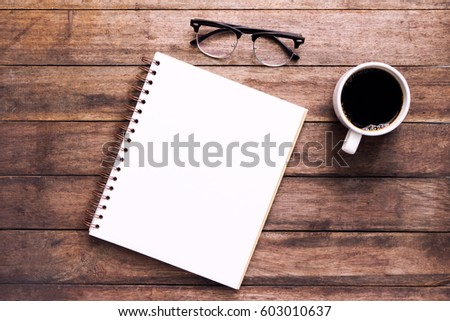 Blank notebook  on the coffee table
