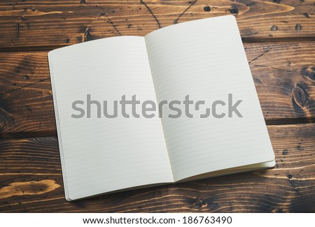 Blank notebook up close on a rustic wooden background #186763490