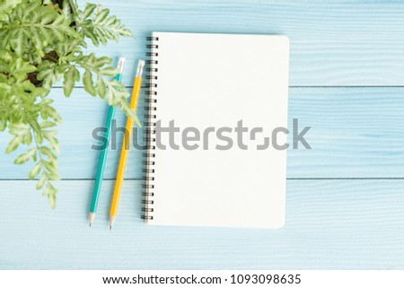 Blank notebook with and pencil on blue background,Flat lay photo of notebook for your message