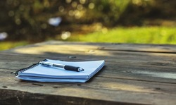 Blank notebook with pen on the table.