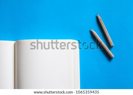 blank notebook with pencil on colorful background #1065359435