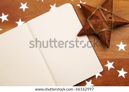 Blank Notebook With Stars On Wooden Background