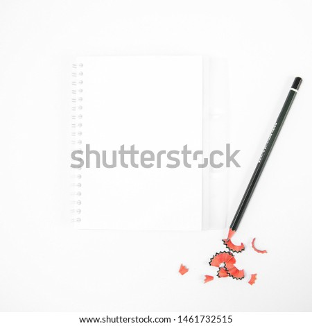 Blank notepad and pencil on white background. Top view, flat lay, copy space #1461732515