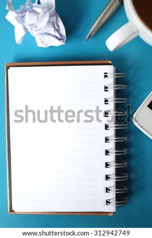 Blank notepad and smartphone with coffee on office table #312942749