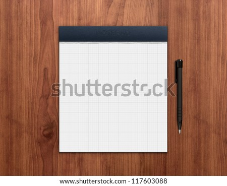 Blank notepad with pen on a wooden desk. High quality graphic collage. - stock photo