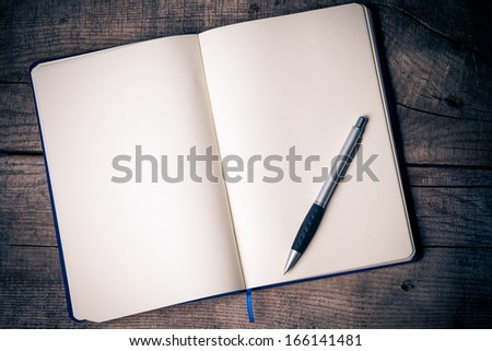 Blank notepad with pen on office wooden table  #166141481
