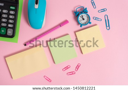 Blank notepads alarm clock wakeup marker wire mouse calculator sheet clips colored background empty text important events home office school house everywhere