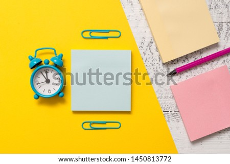 Blank notepads message sticky note letter size sheet marker clips small alarm clock wakeup wooden retro background empty text important events home office school