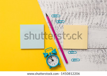 Blank notepads message sticky notes letter size sheet marker small alarm clock wakeup wooden retro background empty text important events home office school