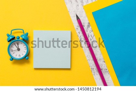 Blank notepads message sticky notes letter size sheets marker small alarm clock wakeup wooden retro background empty text important events home office school