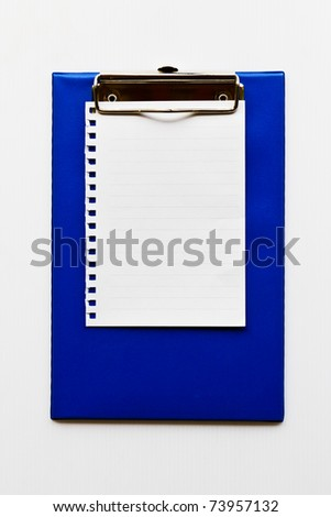 Blank notepaper on a  blue clipboard background.