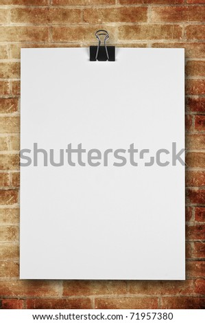 blank notepaper on brick wall