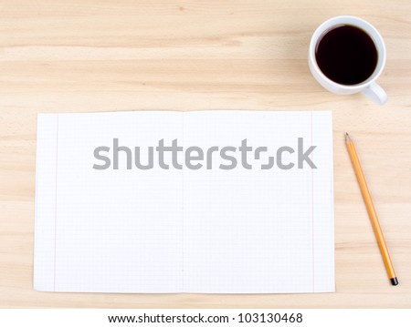 Blank notes on a desk with cup of coffee