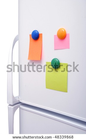 blank notes on fridge with round magnet