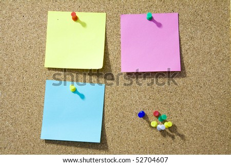 Blank notes pinned on corkboard ready for your text.