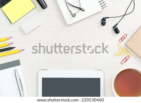 Blank office desk background with copy space for your text. Top view. Business and office supplies with modern digital tablet.