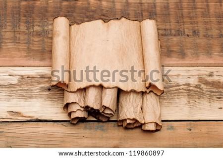 blank old sheet paper on pile scrolls