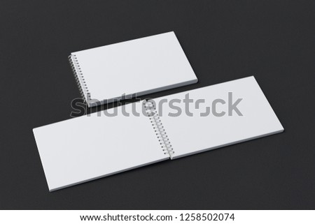 Blank open and closed horizontal spiral notepads on black background. With clipping path around notebooks pages. 3d illustration