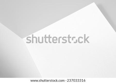 Blank open card or folded sheet of paper
