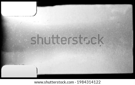 blank or empty 8mm film frame with dust and scratches, cool film border overlay.