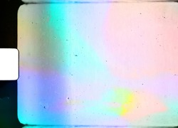 blank or empty super 8 film frame with cool scanning light interferences on the material.