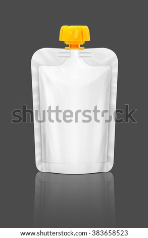 Blank packaging squeeze pouch isolated on gray background with clipping path