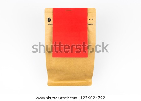 Blank packaging with a blank red label center of frame.