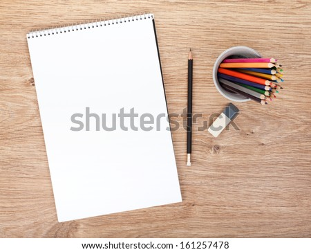 Blank paper and colorful pencils on the wooden table. View from above #161257478