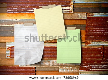 blank paper attach on rusty corrugated iron sheets