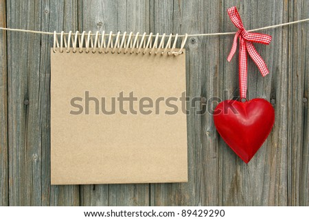 blank  paper background  and red love heart on the wood