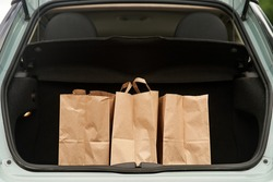 Blank paper bags in a car trunk